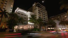T/L WS Traffic on street at night / South Beach, Florida, USA Stock Footage