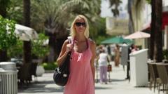 SLO MO MS Young woman walking on sidewalk/ South Beach, Miami, Florida, USA Stock Footage