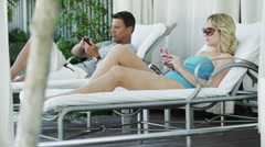 WS TU Men and woman text messaging on patio / South Beach, Miami, Florida, USA Stock Footage