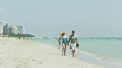 WS Couple walking on beach / South Beach, Miami, Florida, USA Stock Footage