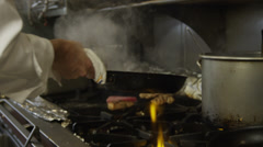 SLO MO MS Chef cooking on stove / Miami, Florida, USA Stock Footage