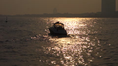 yacht sailing on the sea at dusk - stock footage