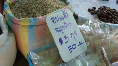 Vendors displaying varieties of raw rice in a market, Chiangmai, Thailand Stock Footage