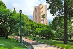 green park and residential building in monte carlo, monaco. - stock photo