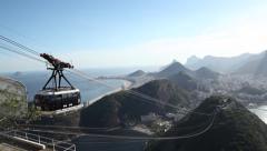 In Rio de Janeiro a cable car leaves Pao de Acucar Stock Footage