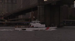 MS PAN Patrol boat passing under Brooklyn Bridge / Manhattan, New York City, New Stock Footage