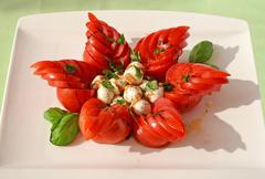 Unusually styled caprese salad with mozzarella cheese, tomatoes and basil Stock Photos