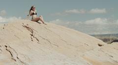 WS TU Young woman relaxing on rock near Lake Powell / Utah, USA Stock Footage