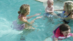 MS Adults playing with kids (6-11 months, 4-5 years) in pool / Cedar Hills, Stock Footage