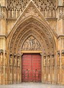 wooden door at the entrance to valencia cathedral. - stock photo