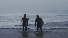 USA, California, Huntington Beach, two surfers looking at waves Stock Footage