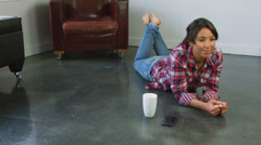 Arabic woman using cell phone in living room texting happy Stock Footage