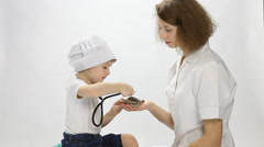 Doctor playing with a little patient with toy and stethoscope Stock Footage