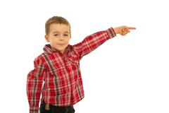 Happy kid boy pointing away - stock photo