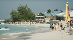 Cayman Islands, Grand Cayman, Seven Mile Beach, People at tropical beach Stock Footage