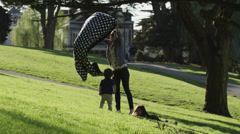 USA, California, San Francisco, Alamo Square Park, Mother with two children Stock Footage