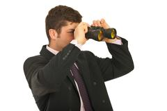 Businessman looking through binocular Stock Photos