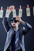 Criminal laundering dirty money Stock Photos