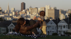 USA, California, San Francisco, Alamo Square Park, Woman with son (2-3) playing Stock Footage