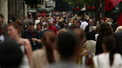 Crowd of people on busy shopping street slo mo - stock footage
