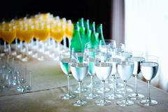 catering drinks. water, soda water, orange juice. - stock photo