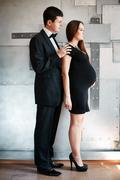 man and expectant mother standing together. - stock photo