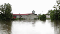 Flooded farm. Environmental disaster. Damaged building after big rain storm. Stock Footage