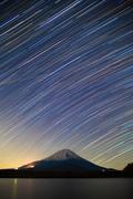 Mount Fuji, Lake Shojiko and star trails of winter stars Stock Photos
