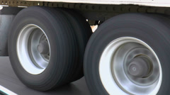 Stock Video Footage of Commercial Semi Truck Tire Wheels Hug Highway Close Up