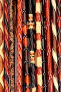 Hand made wooden walking sticks as background - stock photo