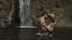 Costa Rica, Esterillos Beach, Couple kissing with waterfall in background Stock Footage