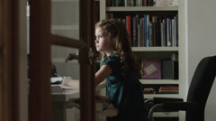 MS DS Girl (8-9) writing at desk / Cedar Hills, Utah, USA Stock Footage