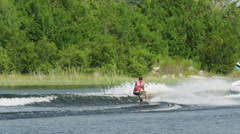 USA, Florida, Young man doing trick on wakeboard Stock Footage