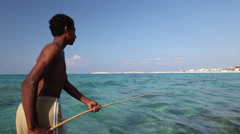 Young boy fishing in Marsa Matruh, Egypt Stock Footage
