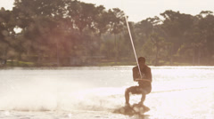 USA, Florida, Orlando, Maitland Lake. Young man on wakeboard Stock Footage