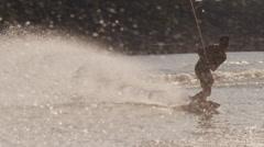 USA, Florida, Orlando, Maitland Lake. Young man on wakeboard Stock Footage