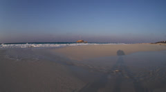 Beach with tripod's shadow in Marsa Matruh, Egypt Stock Footage