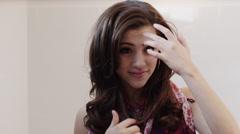 SLO MO MS Woman fixing hair / Salt Lake City, Utah, USA Stock Footage