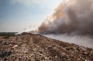 Stock Photo of burning garbage heap of smoke