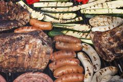 Barbecue with meat and vegetables Stock Photos