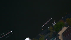Rowing teams in training on the river - stock footage