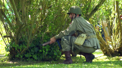 US infantry patrols during the reenactment of Normandy 05 Stock Footage