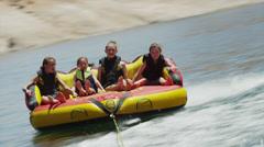BOAT POV WS PAN Tourists (6-15) on inflatable raft / Lake Powell, Utah, USA Stock Footage