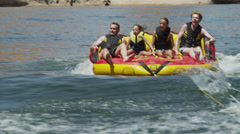 SLO MO BOAT POV WS Tourists (6-15) on inflatable raft / Lake Powell, Utah, USA Stock Footage