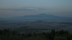 Wide shot of rolling landscape at sunrise / Piensa, Tuscany, Italy Stock Footage