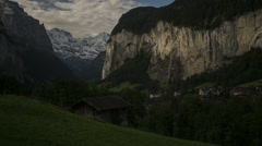 Time lapse of remote village in mountain valley / Lauterbrunnan, Switzerland Stock Footage