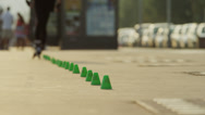 Stock Video Footage of Medium shot of man on rollerblades weaving through cones / Nice, France