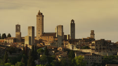 Wide shot of towers in hill town / San Gimignano, Tuscany, Italy Stock Footage