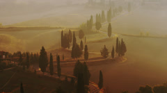 Wide shot of car driving though rural Italian road / Piensa, Tuscany, Italy Stock Footage