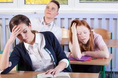 Bored students during lesson Stock Photos